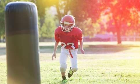 Boy in football gear.