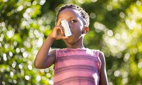Child uses inhaler outdoors