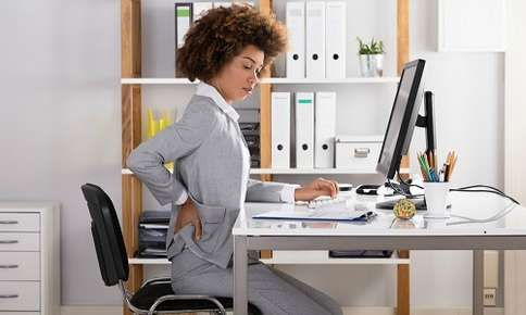 Woman sitting in office chair with bad posture