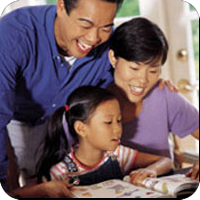 image of parents sitting down with young girl reading