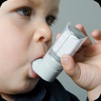 image of young boy using an inhaler