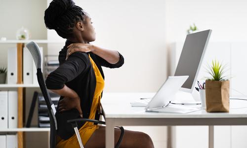 Woman having back pain at work