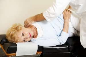 image of woman getting chiropractic adjustment.