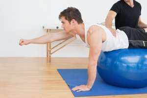 image of chiropractor working with a patient on an exercise ball