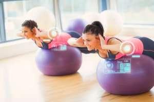 image of couple using exercise balls.