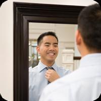 Image of man looking at himself in mirror.