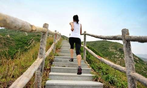 Woman jogging upstairs.