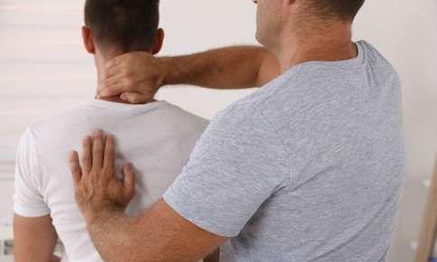Man receiving an adjustment from a chiropractor