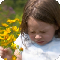 image of young girl about to sneeze